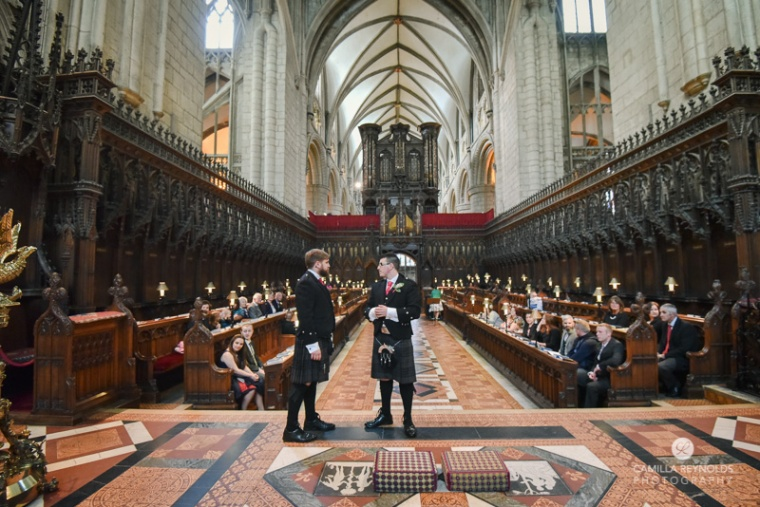 natural wedding photography Gloucester Cathedral groom