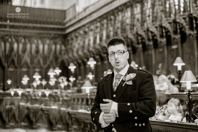 groom waiting natural wedding photography Gloucester Cathedral