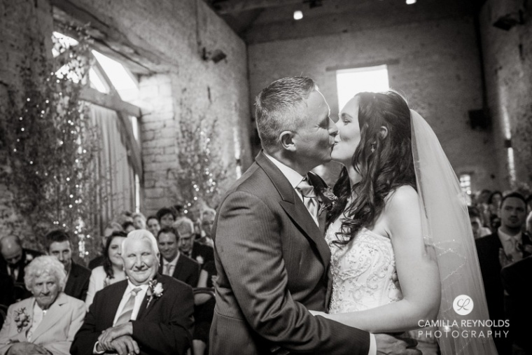 kiss  ceremony Cripps barn  Cotwold wedding photography