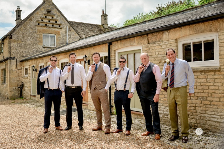 groomsmen pose Cotswold natural wedding photographers