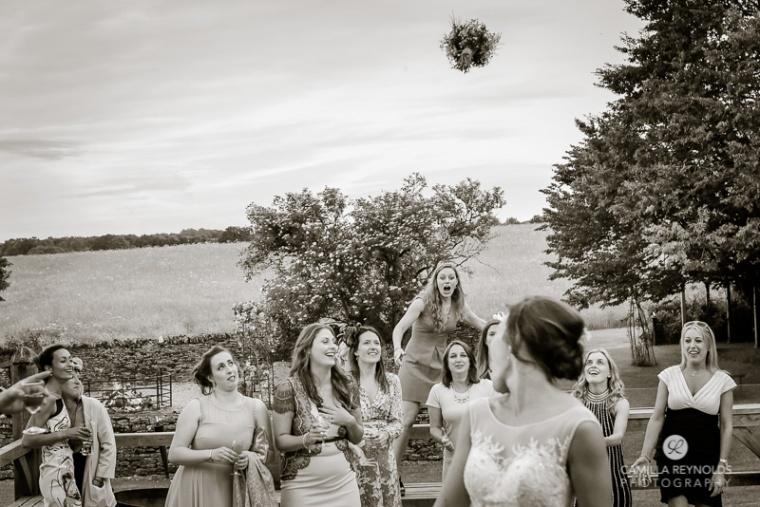 bouquet toss Cripps Barn beautiful wedding photography Cotswolds