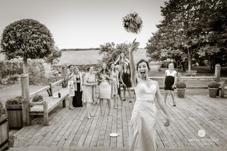 Cripps Barn wedding photography bouquet toss