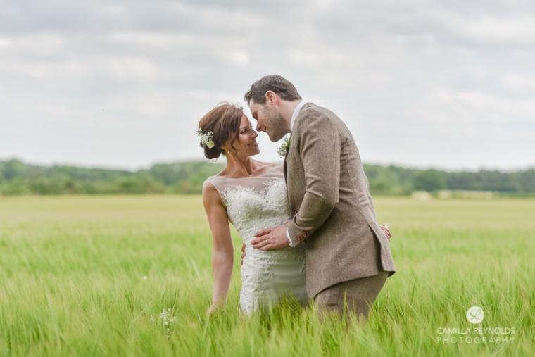 Bride Groom in a field Cripps Barn wedding photography