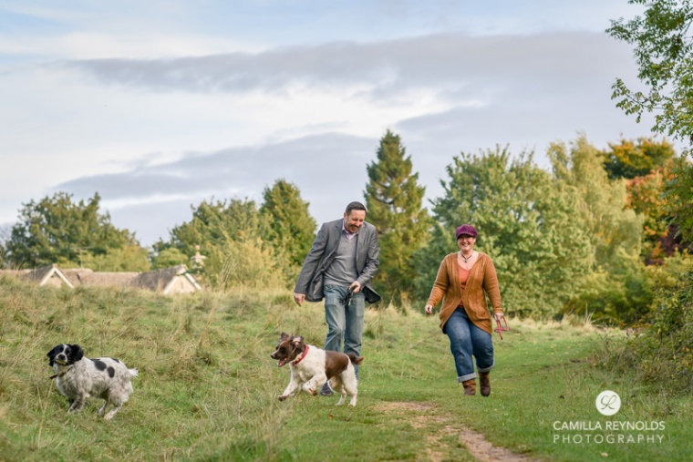natural couple engagement photos with dogs Cotwolds