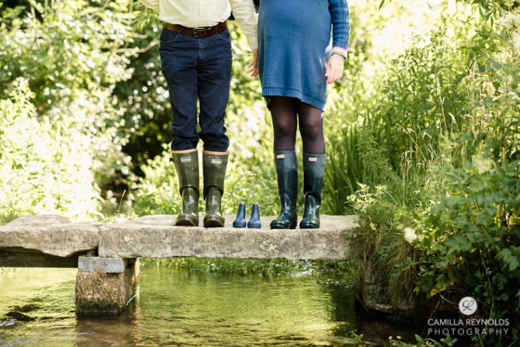 maternity photo shoot ideas baby wellies bridge river