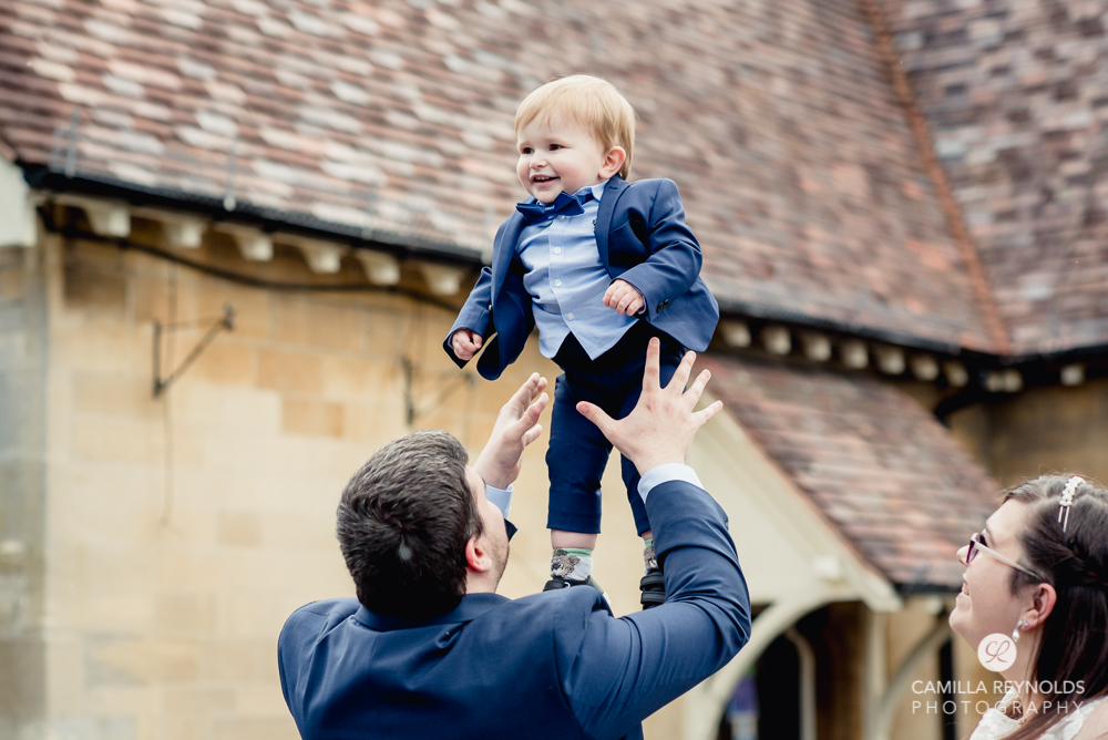 groom and page boy fun relaxed wedding photography Cotswolds