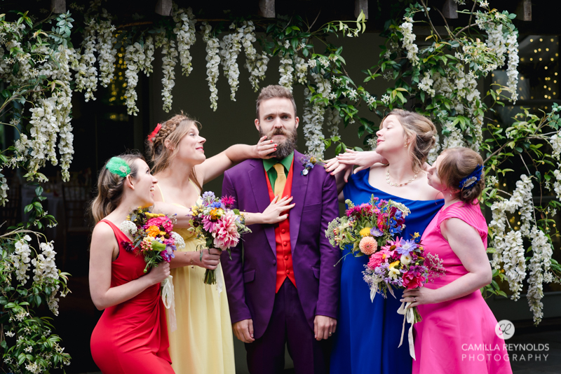 groom and bridesmaids in colourful dresses alternative wedding cotswolds uk