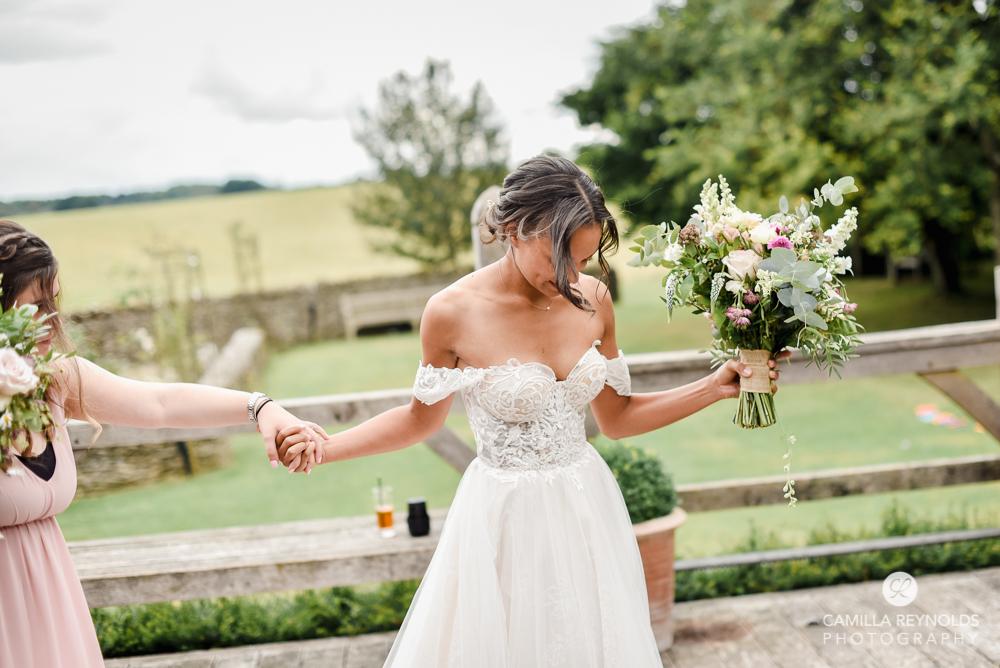bride in romantic wedding dress cripps barn wedding venue