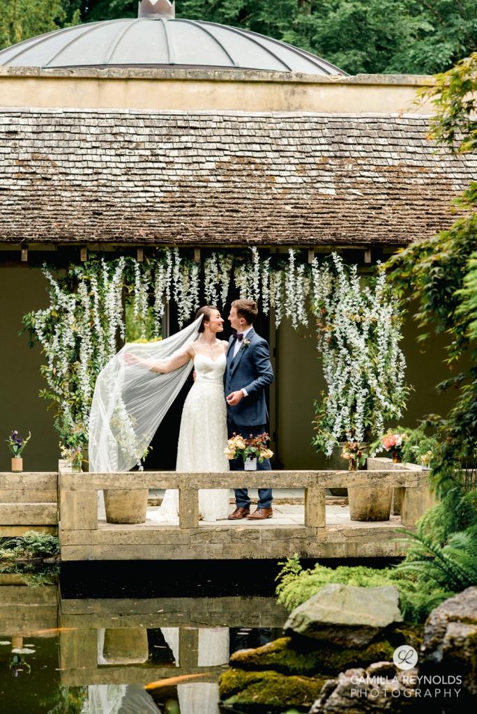 bride flying veil cloistered courtyard matara  wedding venue cotswolds
