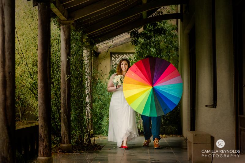 rainbow umbrella vibrant relaxed wedding photography cotswolds