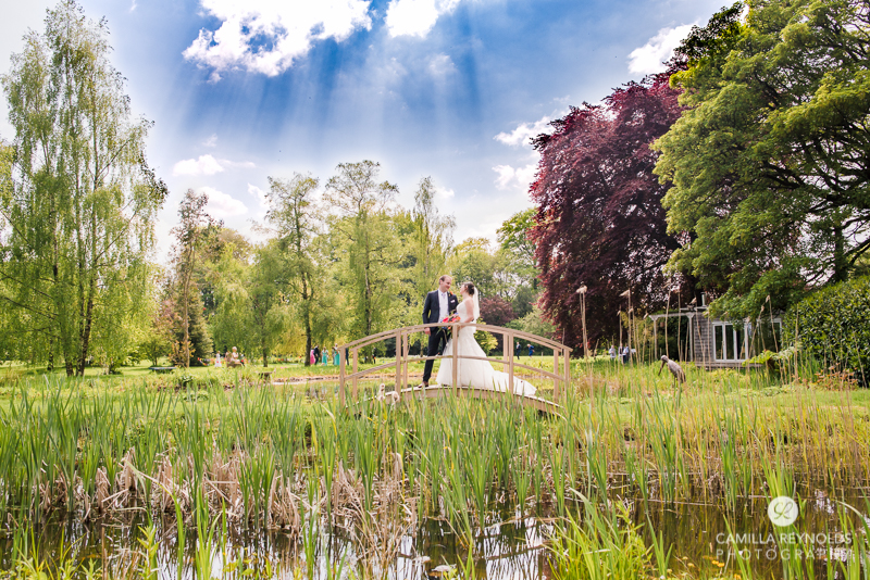 wedding couple on a bridge with stunning view Cotswolds