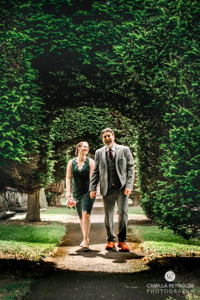 painswick church Gloucestershire yew trees couple walking