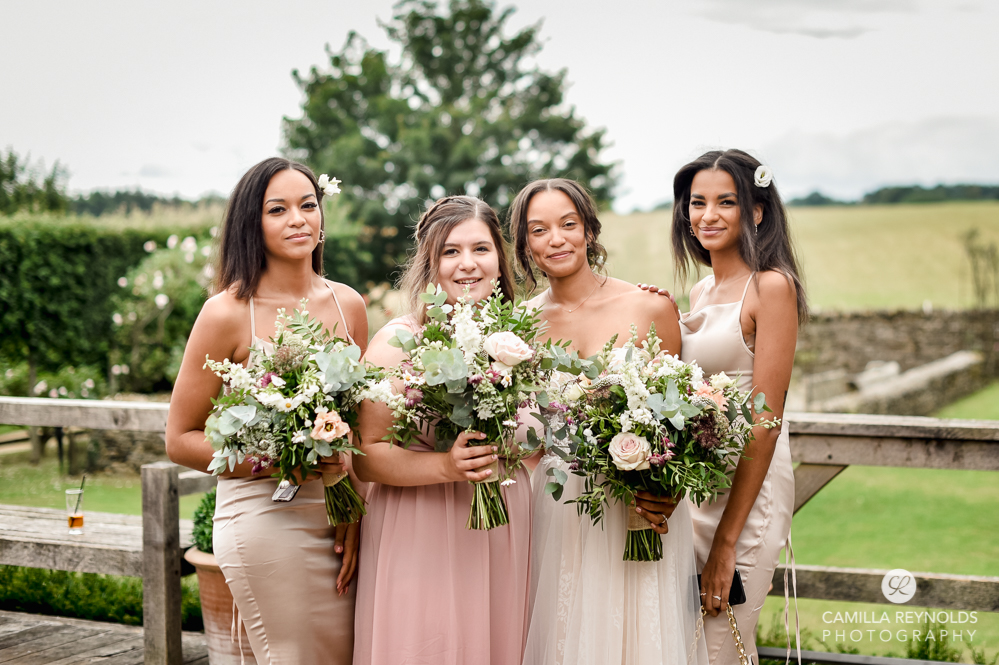 bride and bridesmaids in pink beige dresses cripps barn