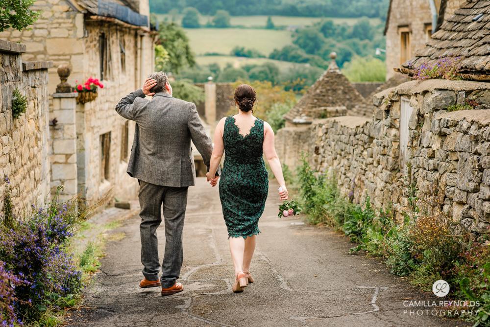 fine art wedding photos bride and groom walking countryside