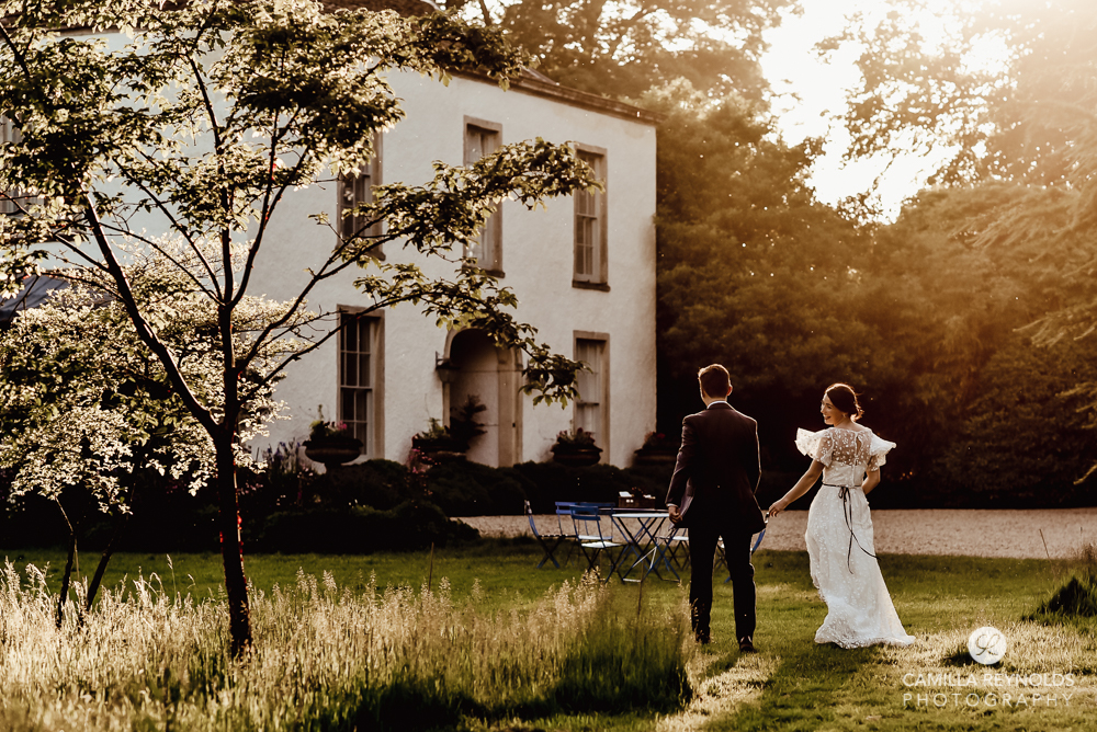 sunset bride and groom walking romantic natural photography