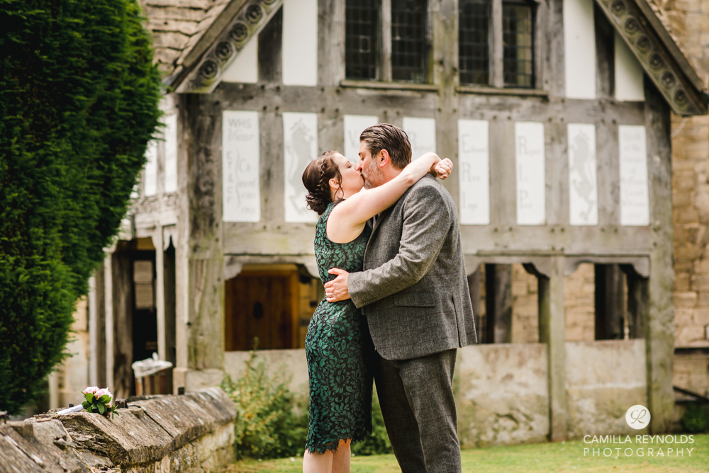 couple kissing old cotswold town engagement photography