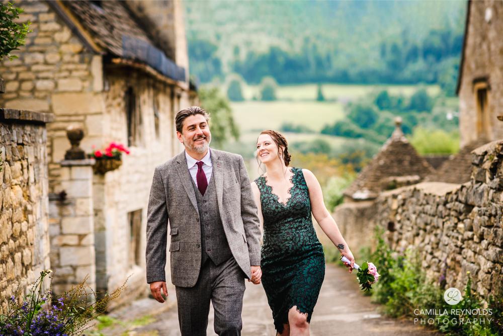 postcard pretty cotswold village wedding couple walking