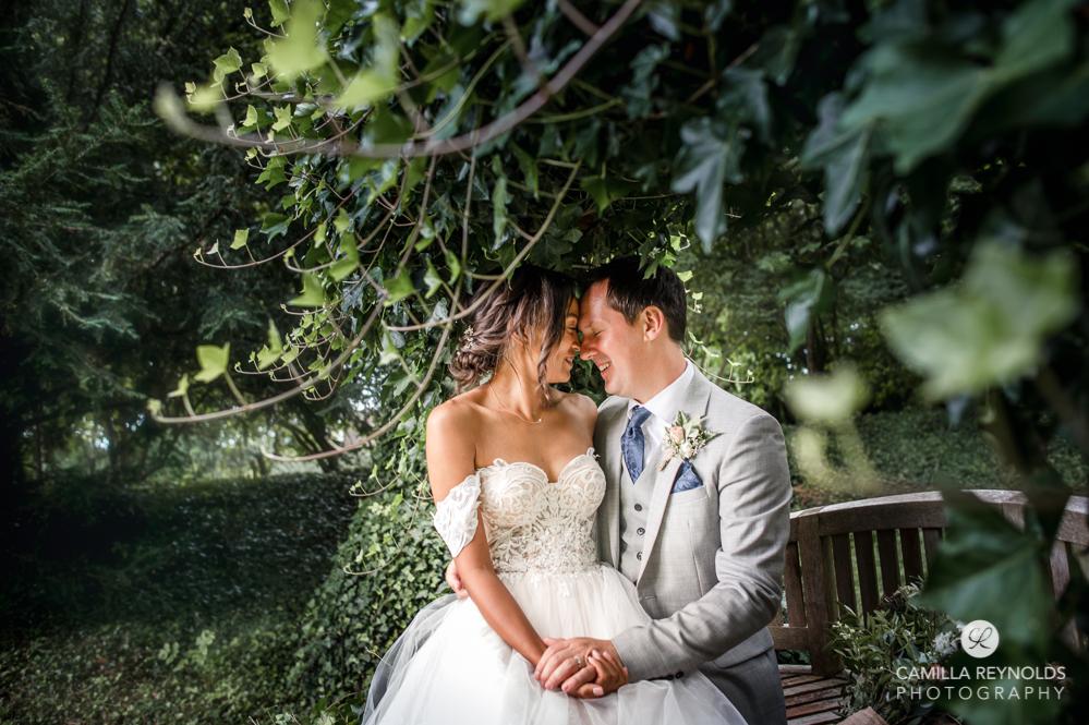 wedding couple on cripps barn bench natural photography