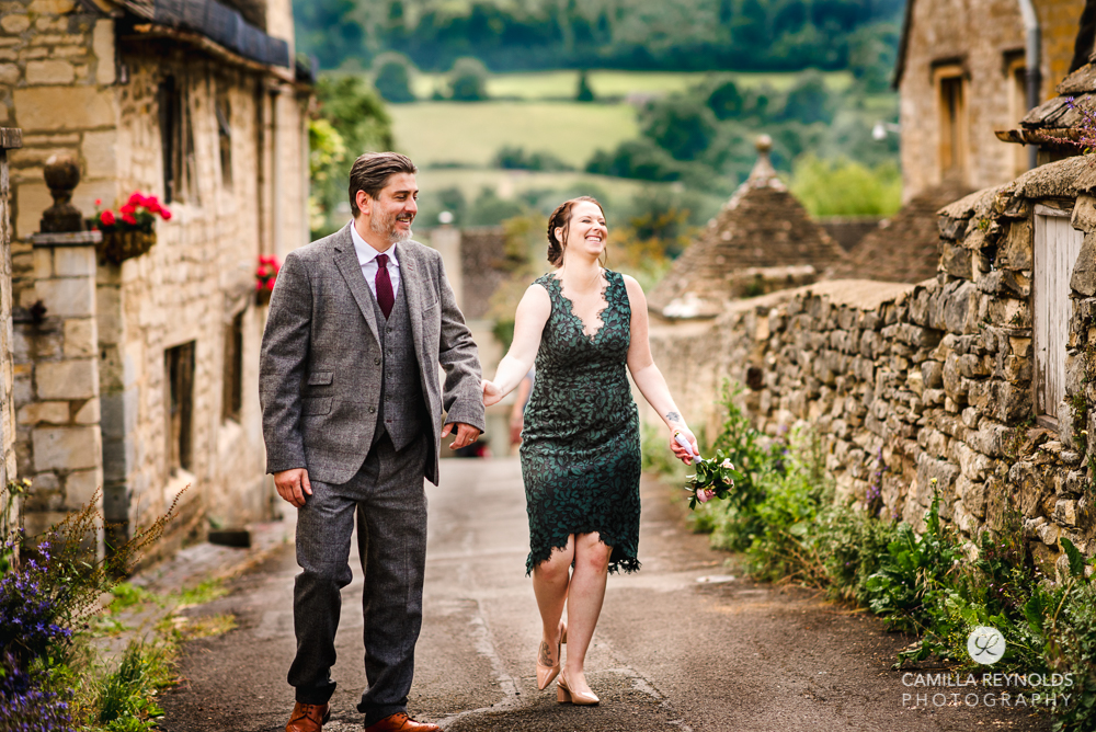 couple walking holding hands natural family wedding photography Cotswolds