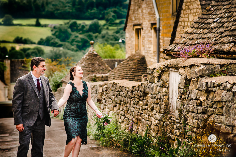 relaxed fun wedding couple walking in cotswold village