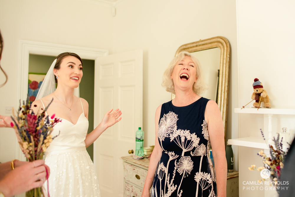 laughing bride and mum natural wedding photography cotwolds