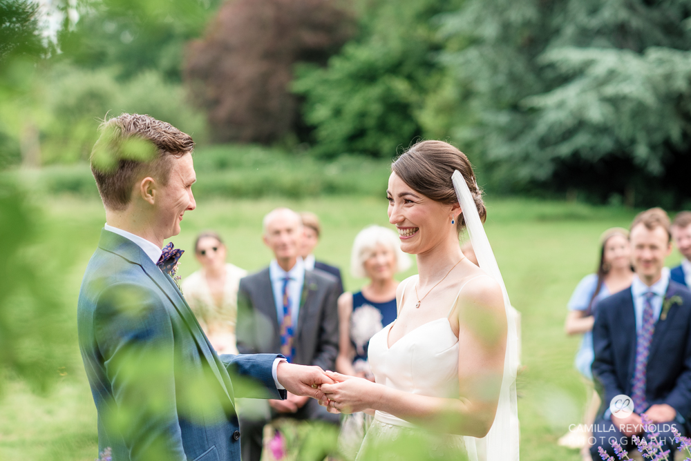 bride groom holding hands wedding ceremony natural photography cotswolds