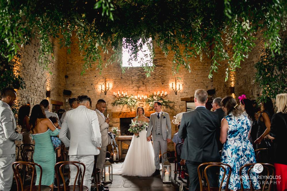 bride and groom at cripps barn wedding venue uk