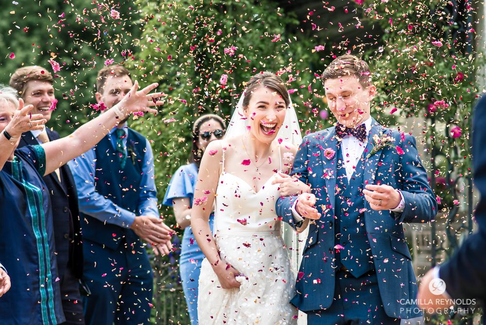 newlyweds confetti shot cotswold natural colourful wedding photos