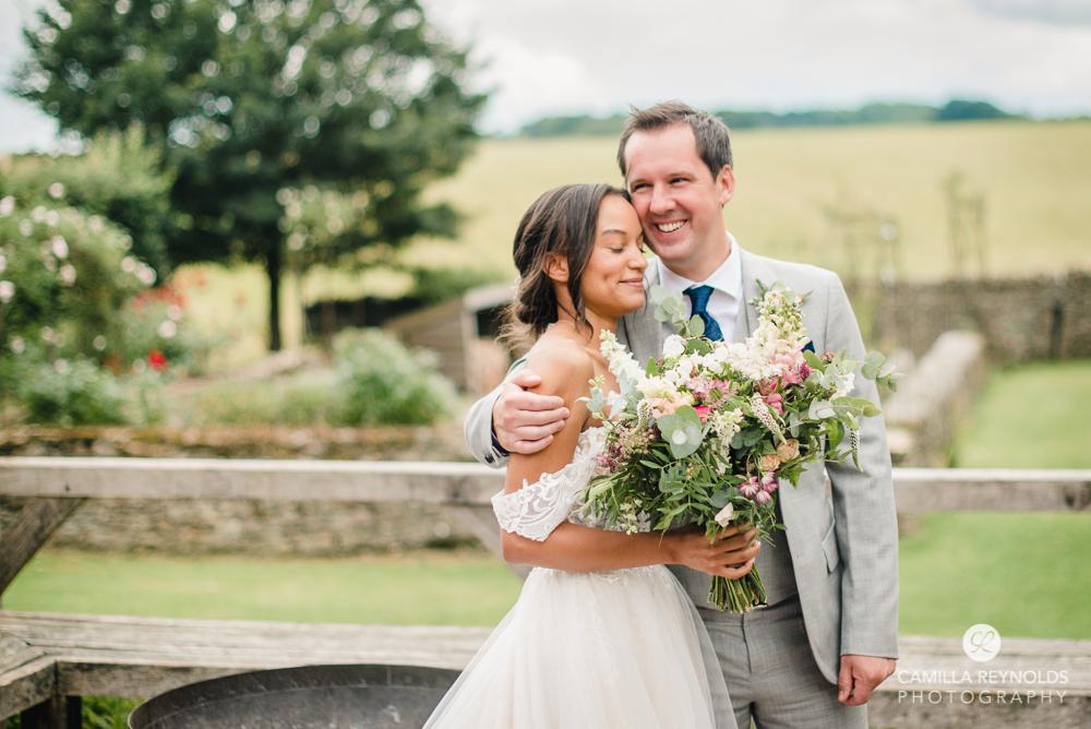 wedding couple hugging light colourful photography