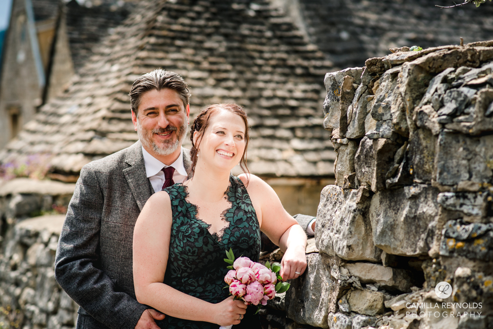 bride and groom cotswolds stone wall wedding photography