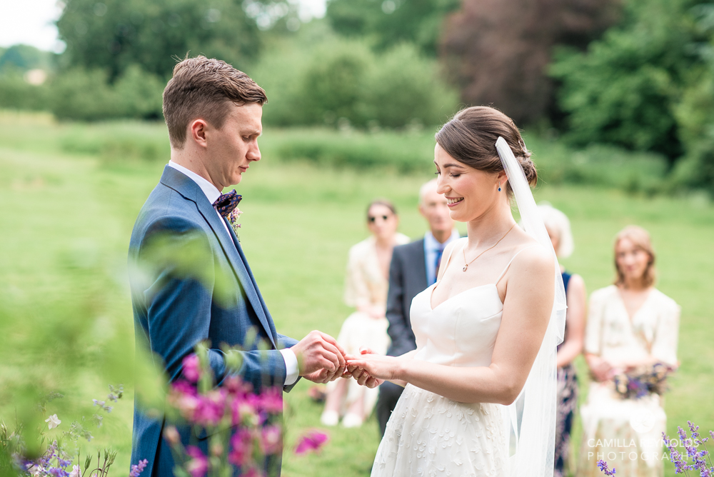 bride groom exchanging rings natural wedding photography whatley manor cotswolds