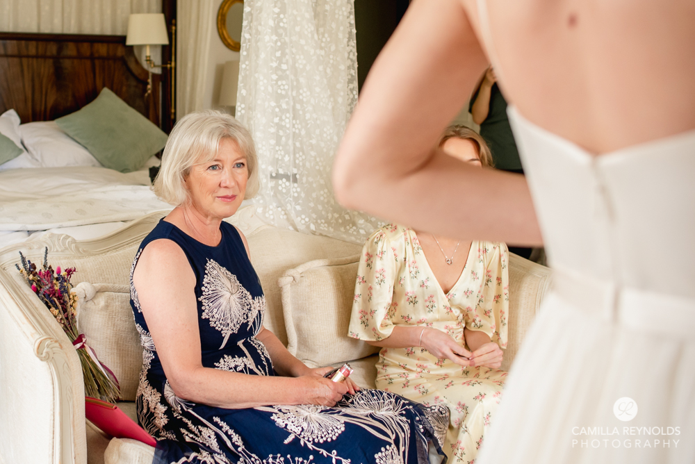 mother of the bride watching bridal prep candid wedding photography