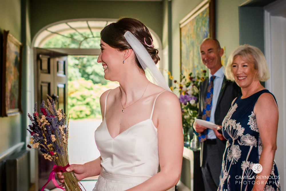 bride walking at Matara wedding centre in the Cotswolds