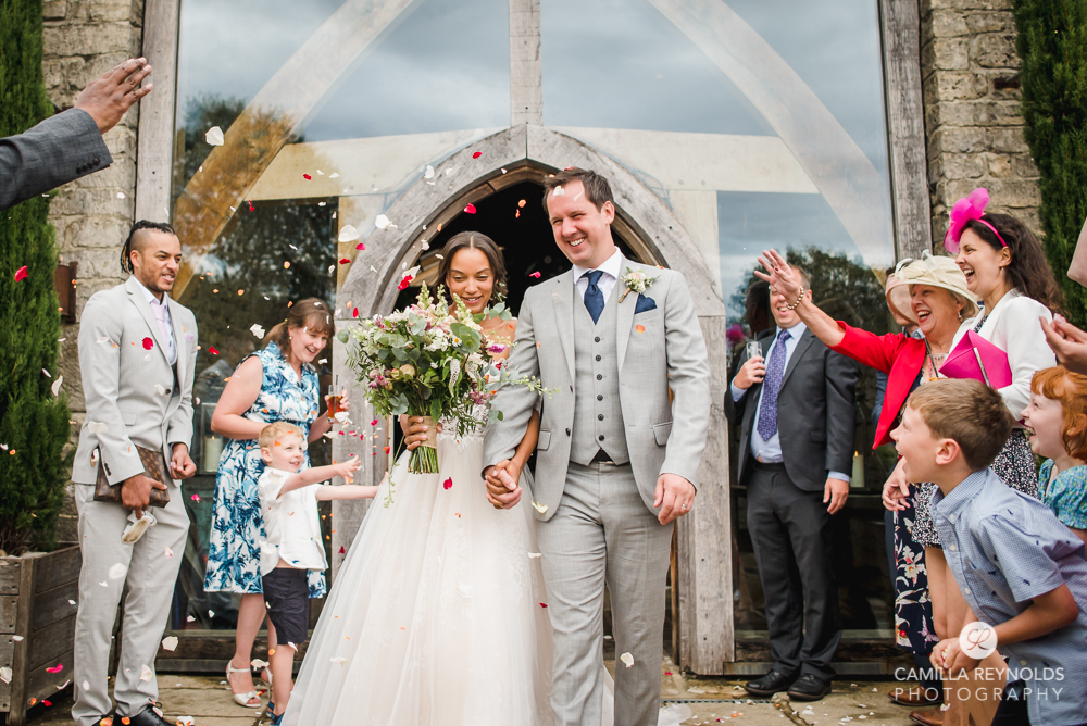 confetti throwing Gloucestershire natural wedding photography