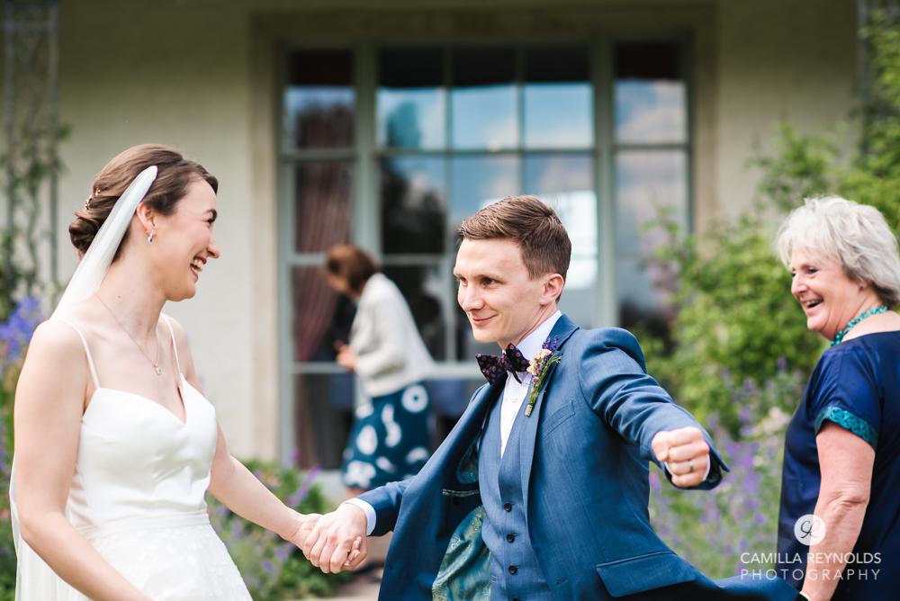 groom fun wedding photos cotswolds uk