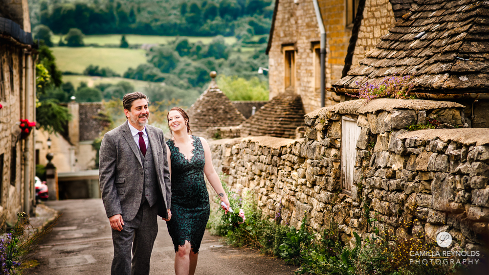 bride and groom walking painwick cotswold wedding