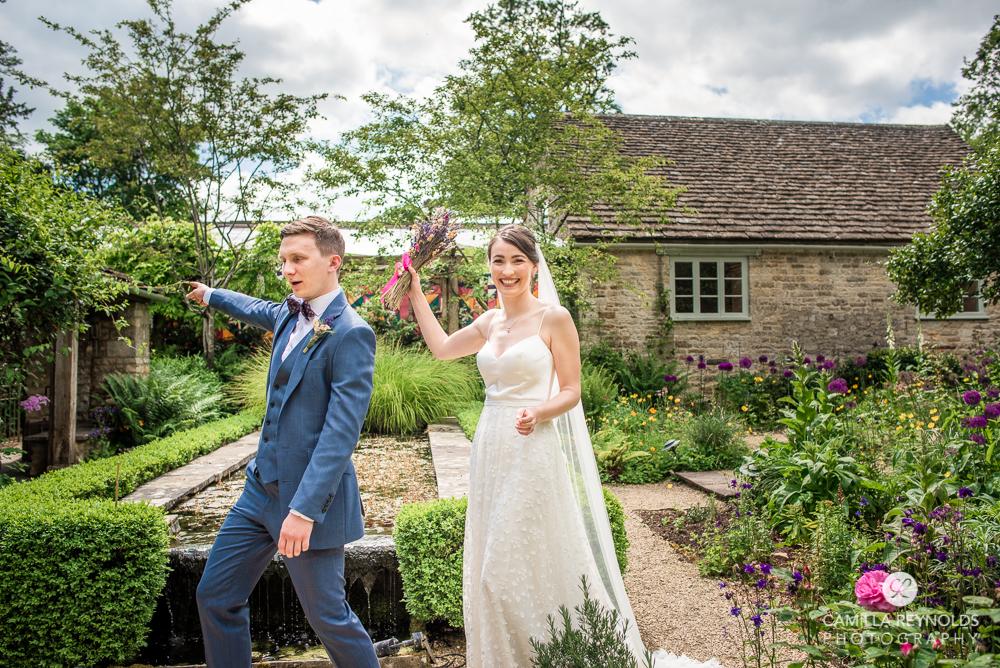 fun photo of bride and groom garden wedding matara cotswolds