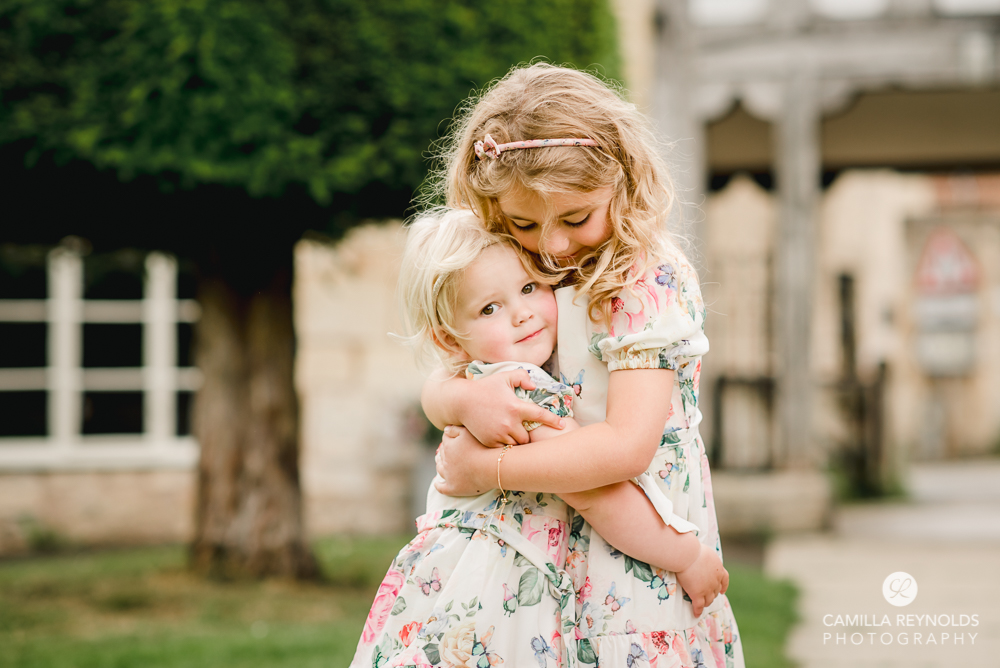 flower girls hugging wiltshire natural wedding photography