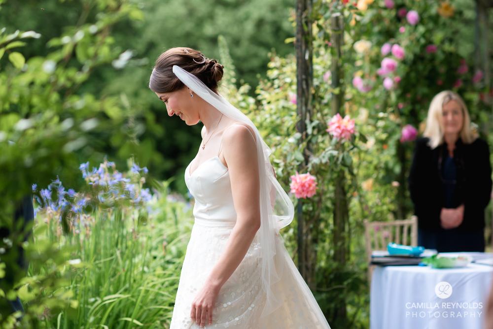 bride walking kingscote barn colourful light wedding photography cotswolds