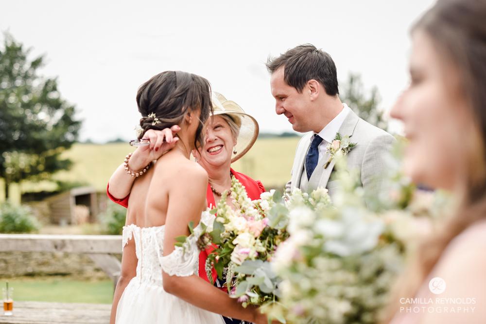 wedding guest hugging bride Gloucsetershire