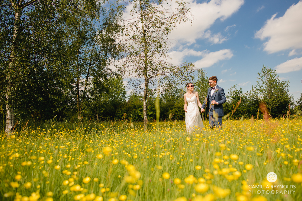 bride and groom in meadow natural wedding photography cowley manor owlpen
