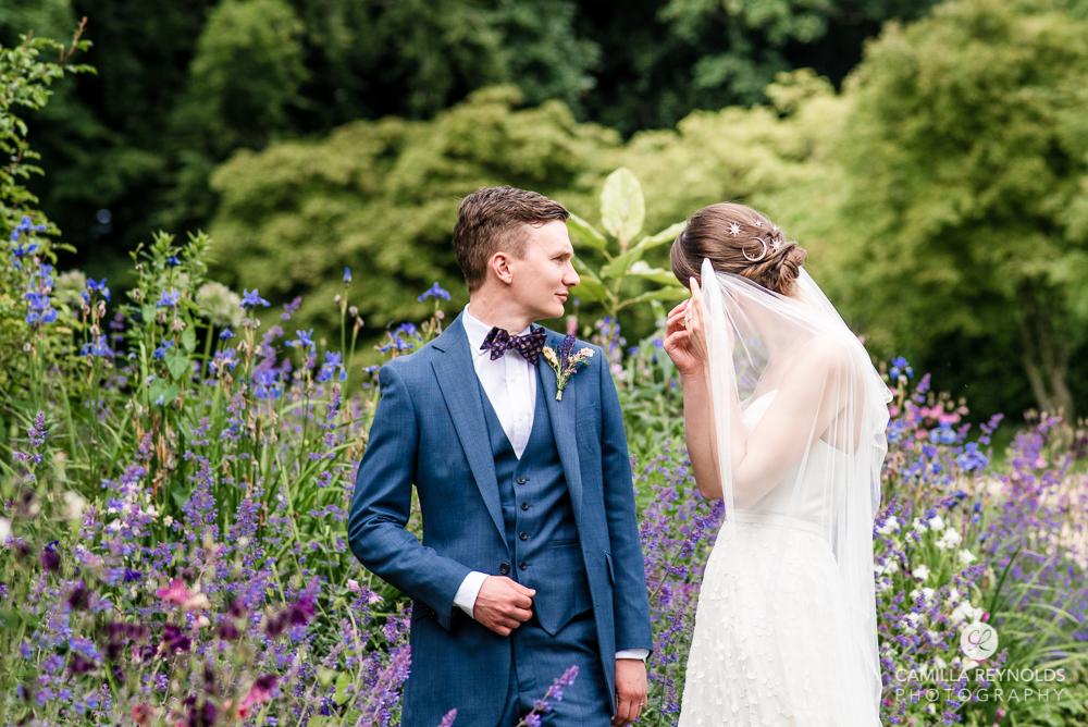 bride adjusting veil wedding photography Cheltenham manor by the lake