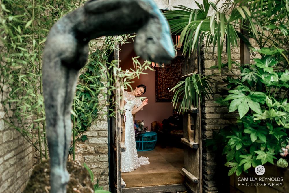 bride in doorway natural wedding photography matara gloucesetershire
