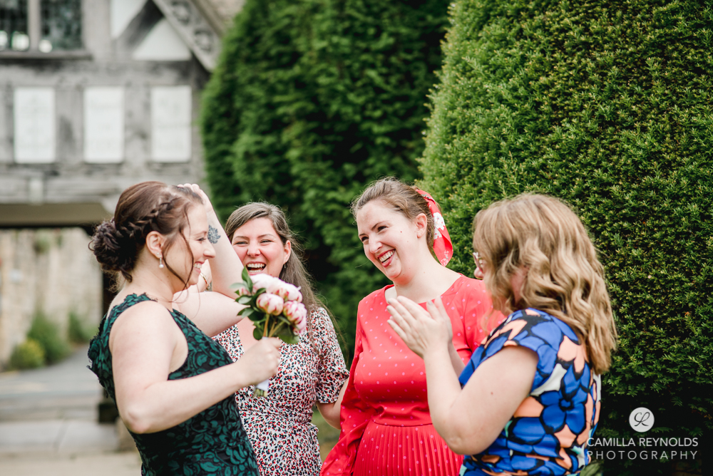 fun natural wedding photography st marys church painswick gloucestershire