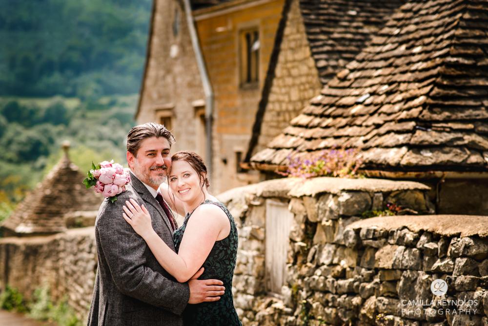couple hugging wedding photography cotswolds
