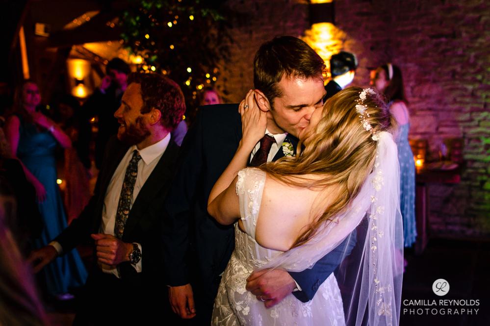 bride and groom kissing on dance floor cripps barn cotswold wedding