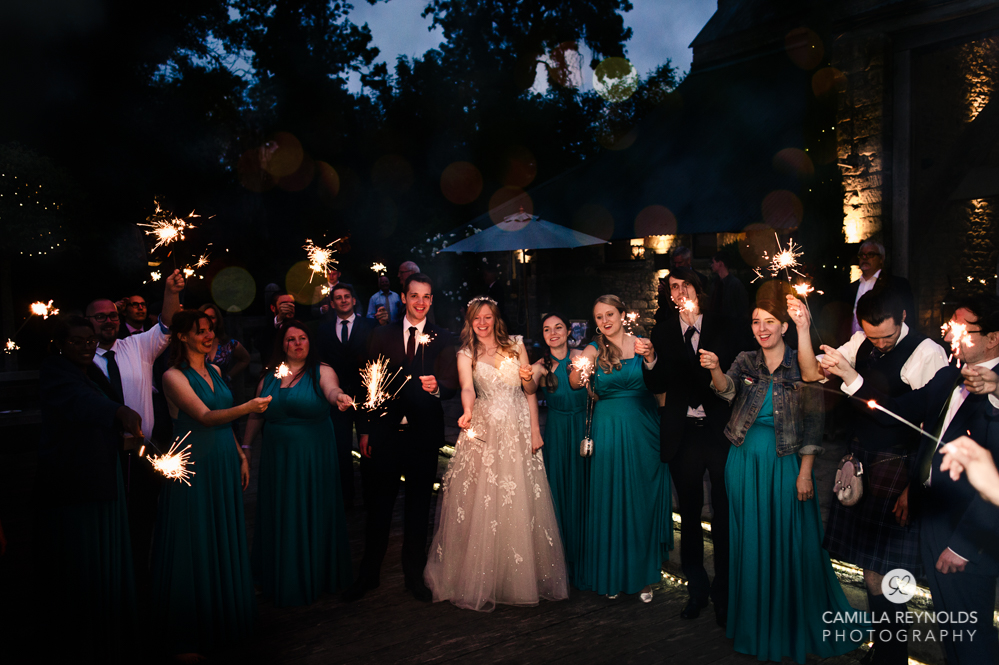bride and groom with sparklers cripps old gore stone barn cotswold wedding