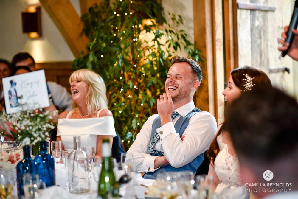 groom laughting speeches fun natural wedding photography cripps barn