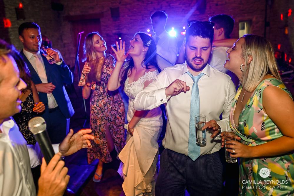 bride singing dancing fun natural wedding photography uk