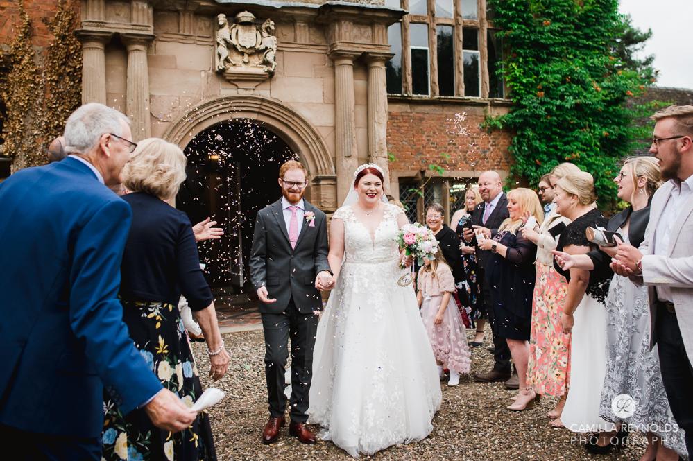 bride and groom confetti shot at Grafton manor midlands wedding photography